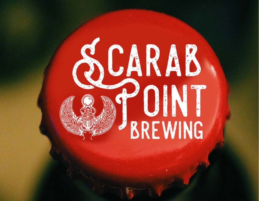 Carrboro Creative graphic design scarab point bottle top
