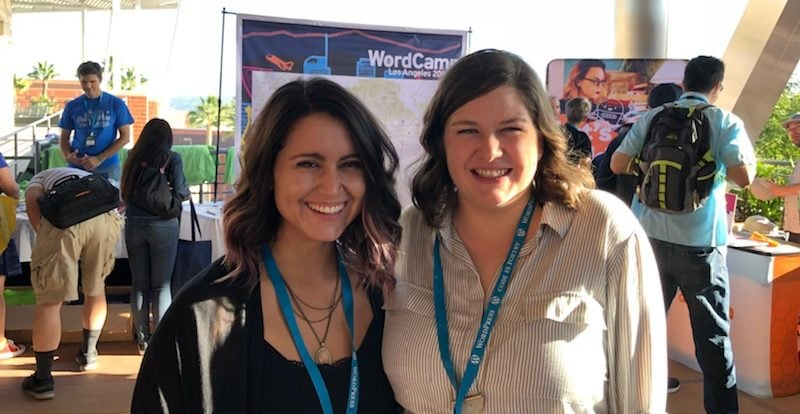 Image of Caity Kelly and Victoria Cole in front of the WordCamp LA banner in Los Angeles at the WordPress conference