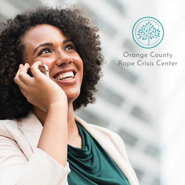 Woman on phone branding orange county rape crisis center