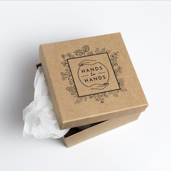 Hands to hands cardboard box mockup