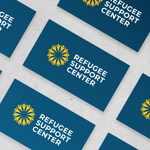 Refugee support center blue business cards with white and gold RSC logo
